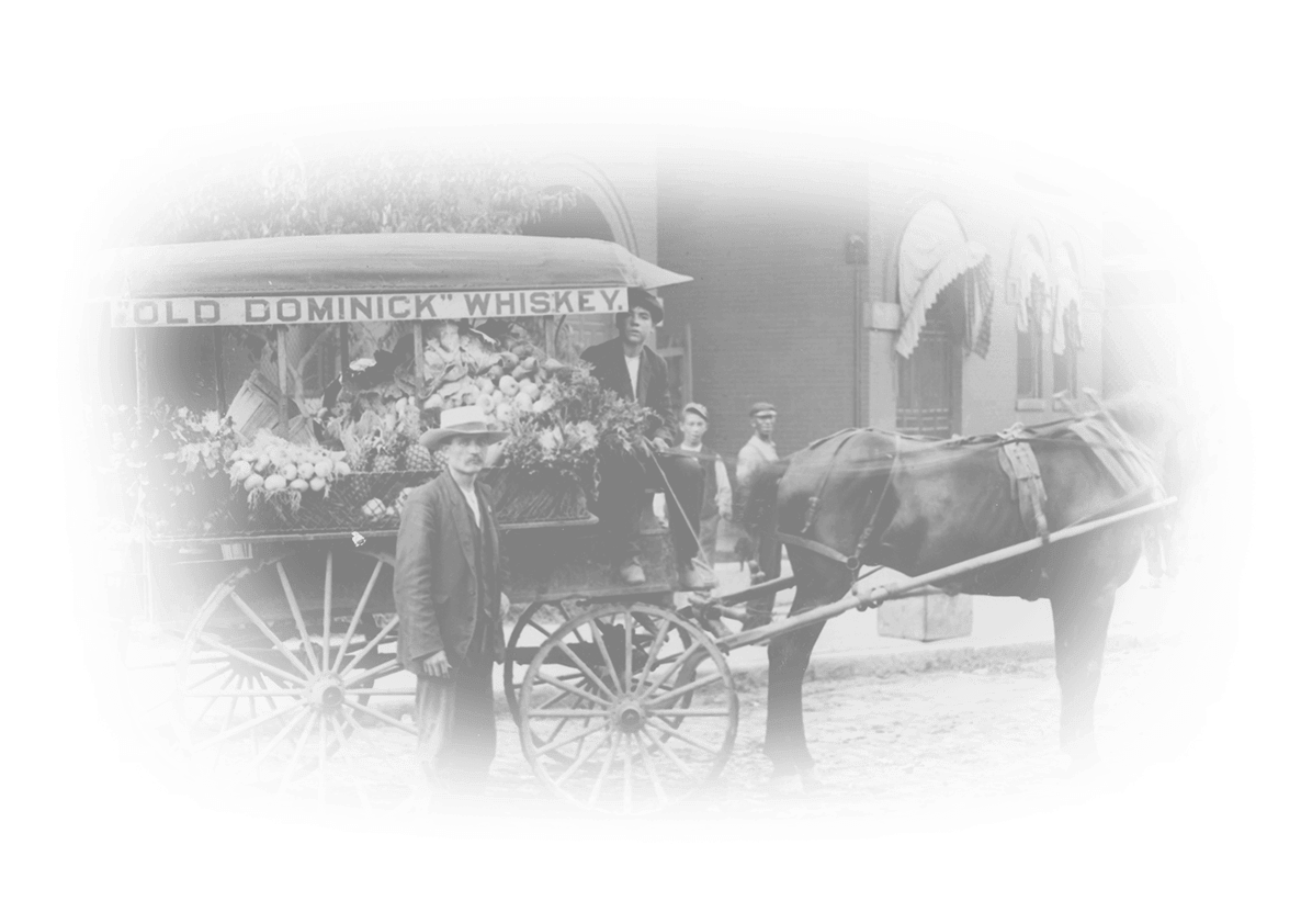 "Horse drawn cart with ""Old Dominick Whiskey"" on the side"