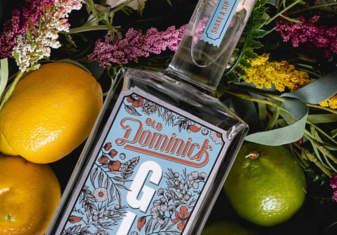 Formula Number 10 Gin bottle surrounded by citrus fruits and flowers